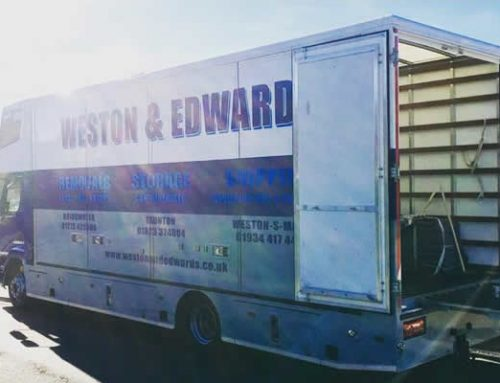 Sunny day in Highbridge, Somerset unloading removal van
